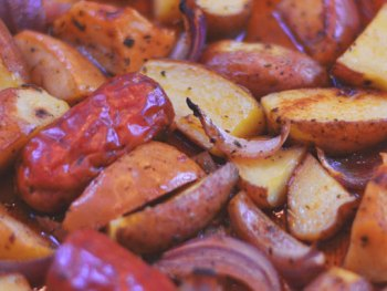 Cajun Taters & Sausage - an easy sheet pan supper from Cosmopolitan Cornbread. Perfect for your Football Festivities!