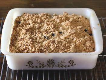 Enjoy the rustic flavor of this Old-fashioned Blueberry Cornbread Cake with crumb topping. Get this old-timey recipe from Cosmopolitan Cornbread.