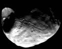 This image is of Mars's moon Phobos.  Crater Stickney is on the left.  Credit: NASA Viking orbiter.