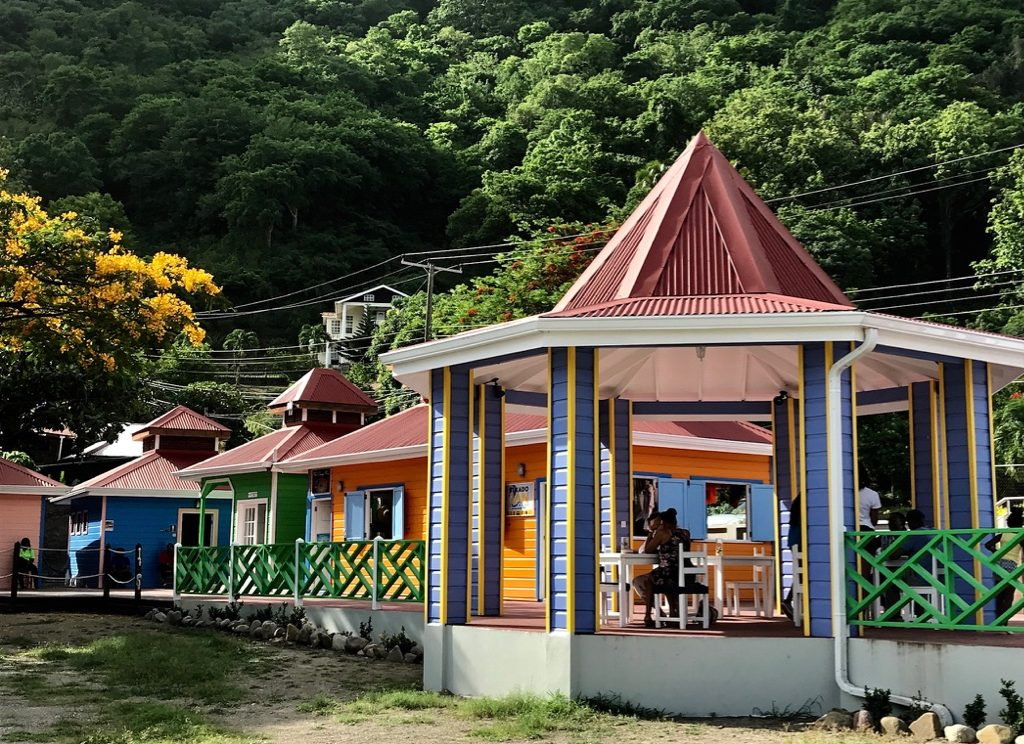 Carribean beach huts painted in bright primary colours