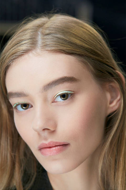 "Peter Philips, Creative and Image Director for Dior Makeup, set a modern trend for delicate expressions of colour next Spring. The ""Pastel Eyes"" were created using laser-cut patches of satin, in a similar ilk to Fendi's demonstration of leather liner. We love this trend! Stick on material eyeliner as you would falsies with eyelash glue and keep the rest of your makeup natural."
