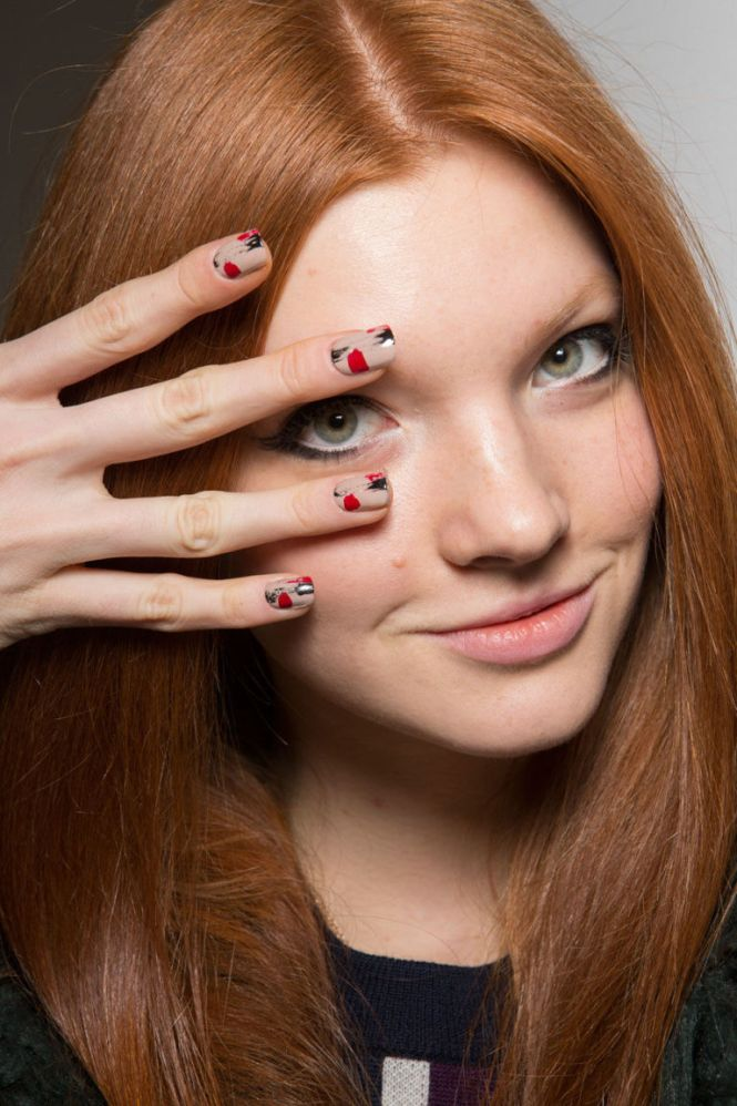 Model With Black Lips Nail Art And A Ring