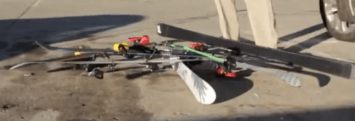 Skis, falling off the car, onto the ground