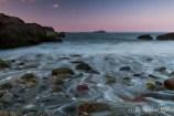 Waves trickling through polished pebbles before Egg Rock.  Nahant, MA, 2012.