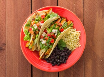 Costa Vida chicken tacos with beans and rice.
