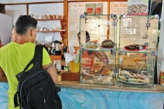 Ricky; buying products at Samara's organic market