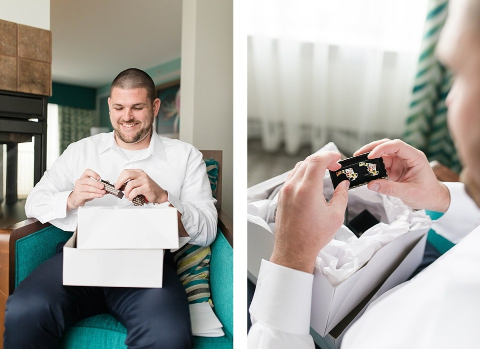 groom opening up cufflinks on his wedding day