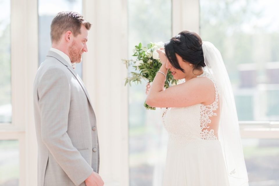 first look on a wedding day at the embassy suites berkeley heights by Costola Photography