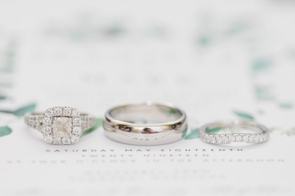 wedding rings at weatherly waterfront farm photography by costola photography
