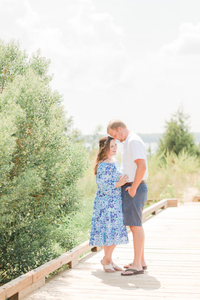 husband and wife at Playful Beach Family Session in Southern Maryland by Costola Photography