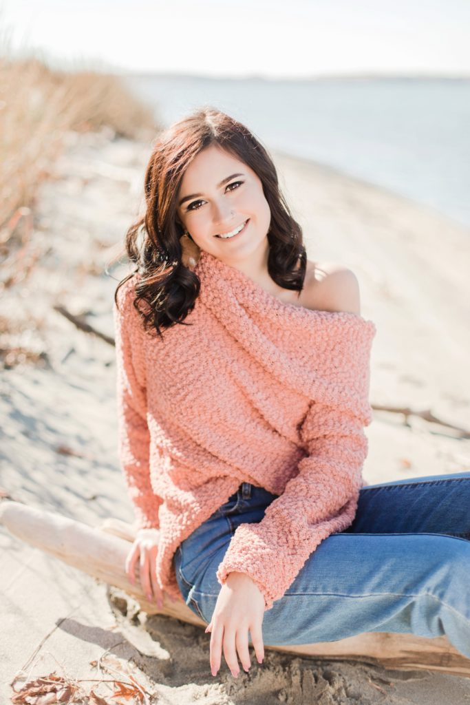 La Plata High School Senior Girl Laughing in pink sweater by Costola Photography