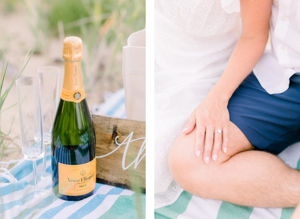 Couple drinking champagne on the beach at a Romantic Eastern Shore Engagement Session by Costola Photography