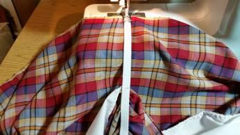 top elastic on sleeve, sewing edge, preparing to stretch
