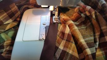 sewing on the binding for the elastic