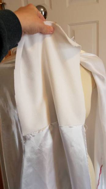 flap of nonslippery fabric to tuck in dress top