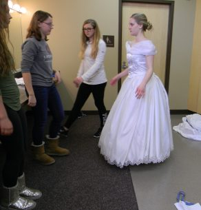 A mirror check and she is done --in the show she also changed shoes
