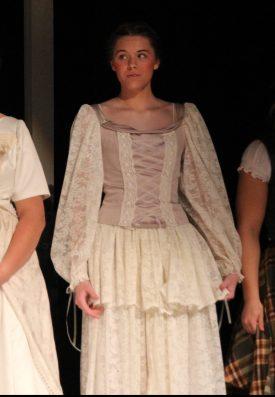beige satin dress with cream curtains