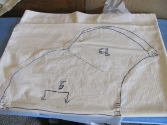 pattern laid out on the pillowcase fold, cutting out both sides at once