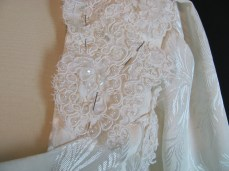 pinning on bits of lace to fill in the sides
