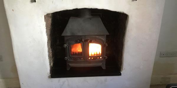 Village woodburner stove & slate hearth installation in Minehead