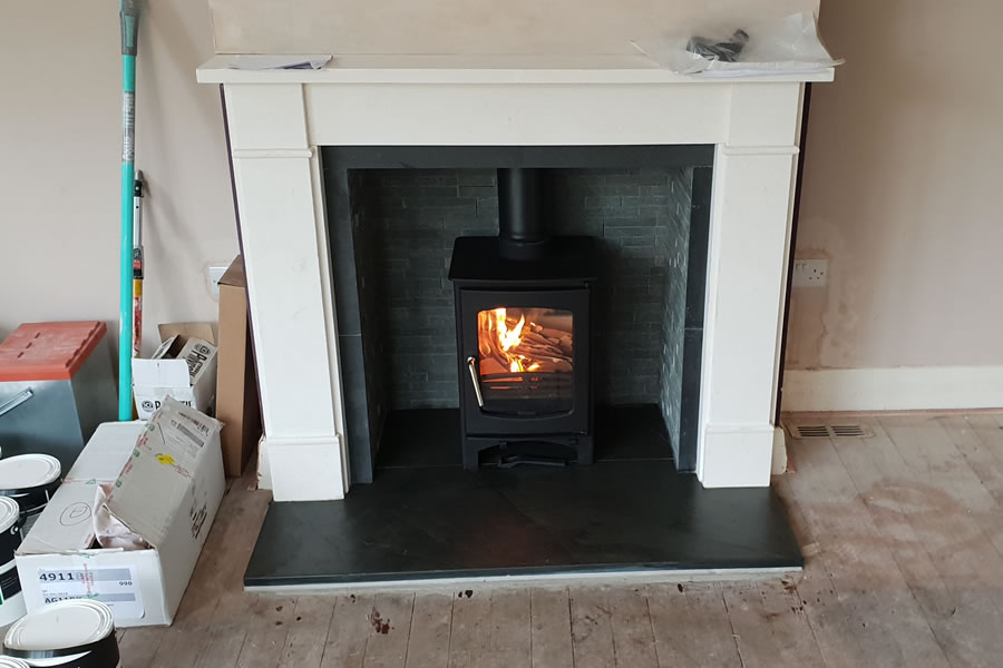 Installation of Ecosy Curve Defra Wood Burner in Porlock