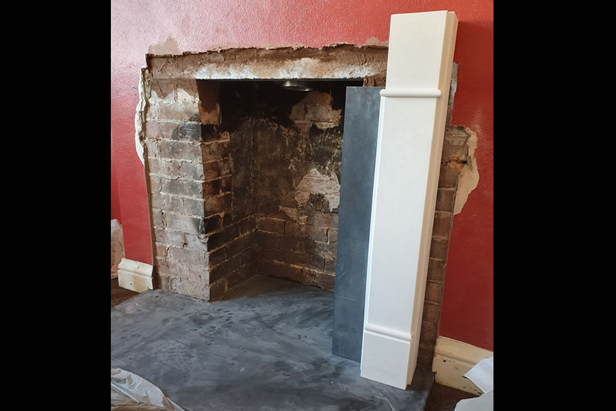 Hearth has tp be perfectly level for stone surround to fit flush