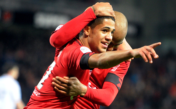 Guingamp's French defender Ludovic Blas (L) is congratulated by Guingamp's French forward Jimmy Briand after scoring a goal during the French L1 football match Guingamp vs Troyes on February 3, 2016 at the Roudourou stadium in Guingamp, western France. / AFP / FRED TANNEAU (Photo credit should read FRED TANNEAU/AFP/Getty Images)