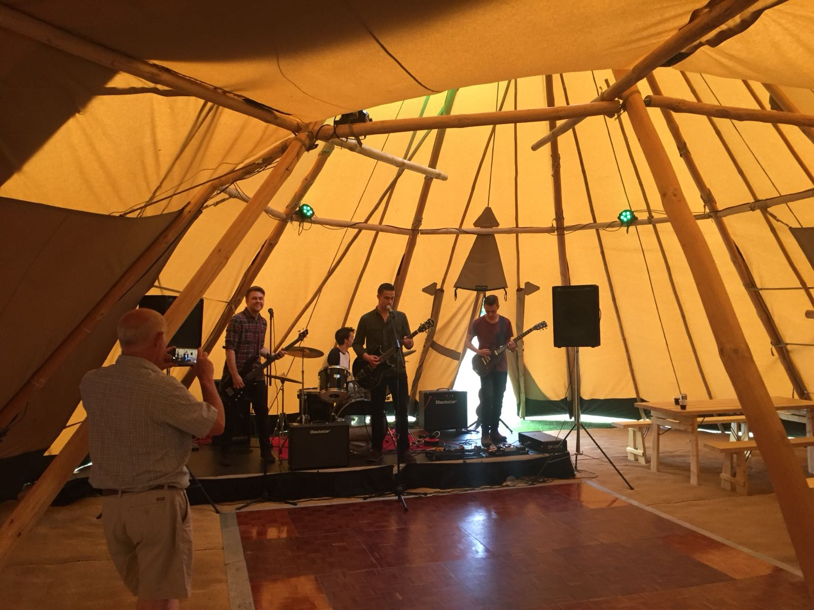 Band playing in the tipi clubhouse at The Open Camping Village 2018
