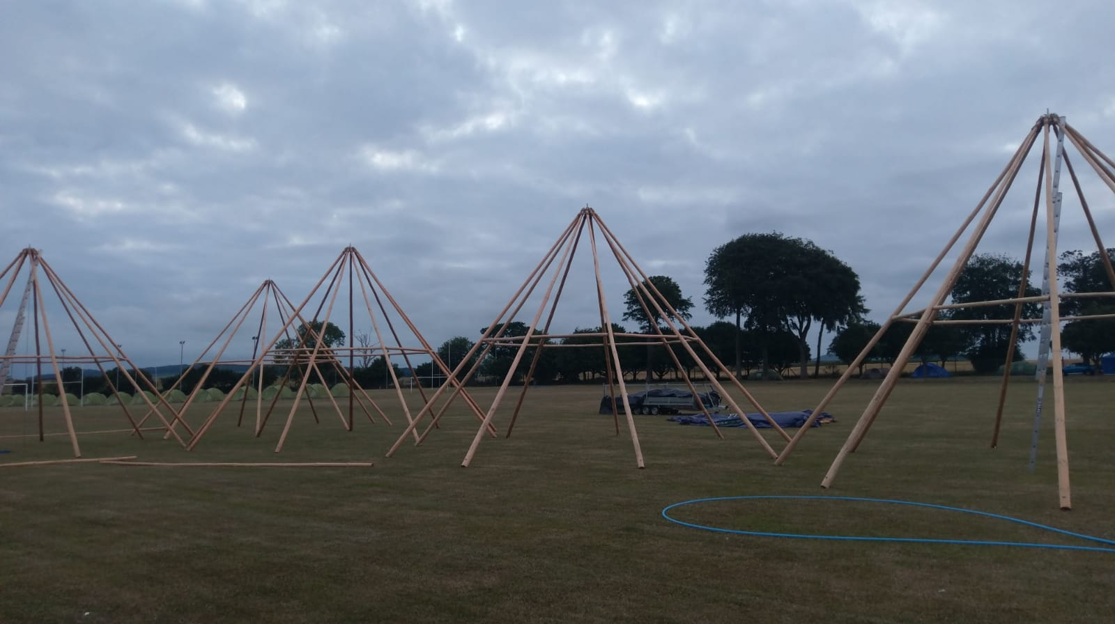 Something magical about just the Tipi Frames - geometry fans loving The Open Camping Village build