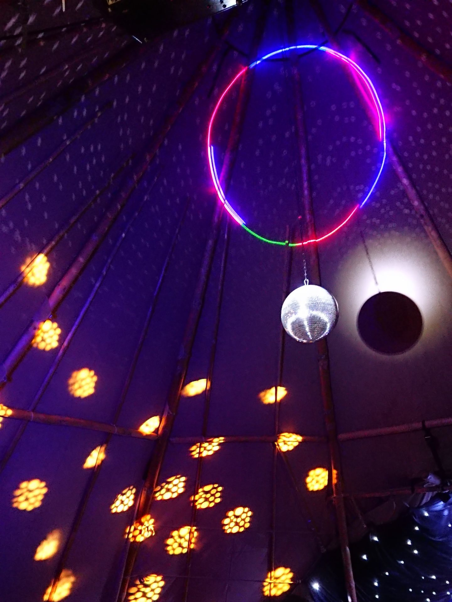 Mirror ball in tipi with strobe lighting
