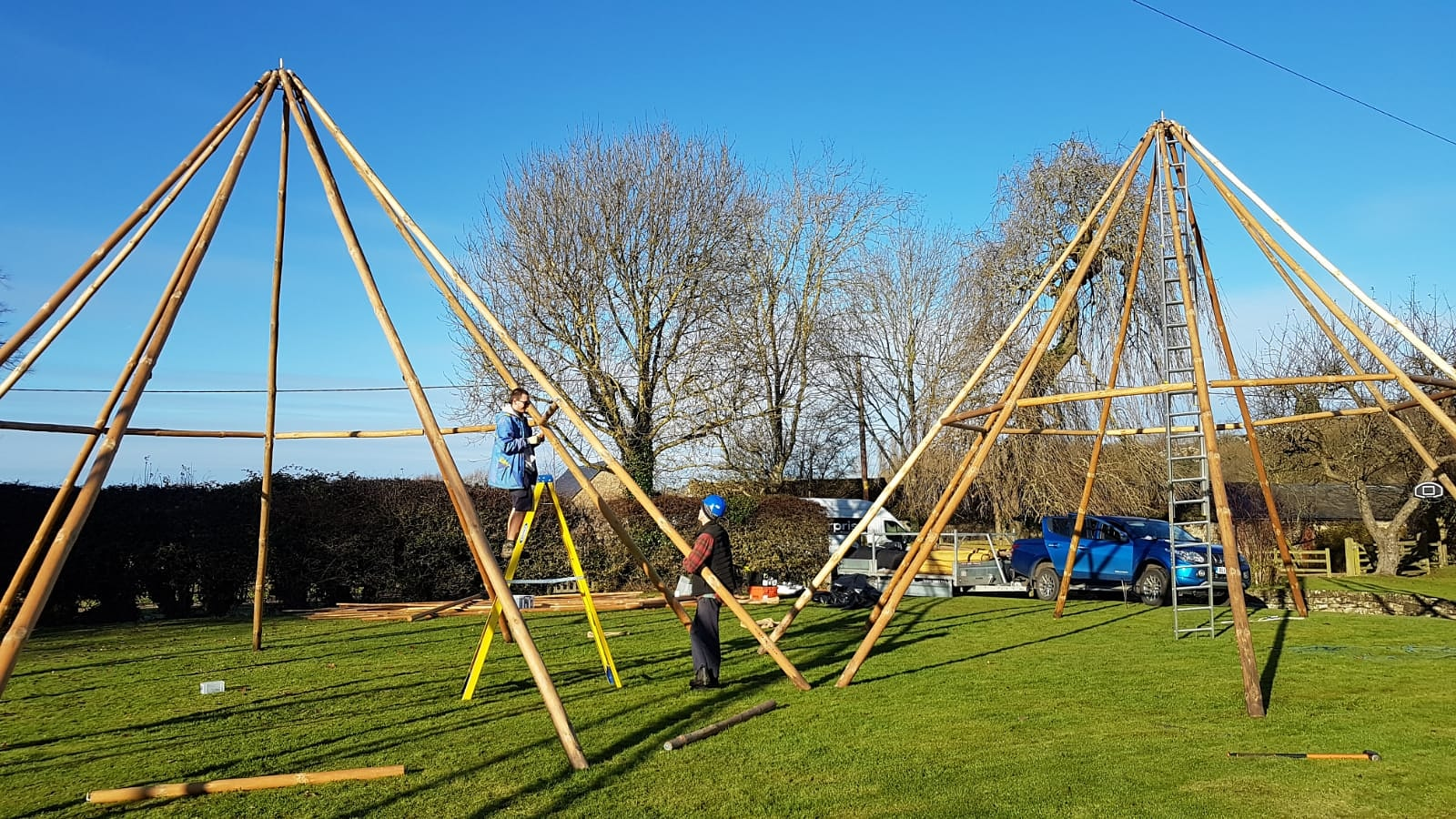 Cotswold Tipis team building three giant hat tipis without the canvases.