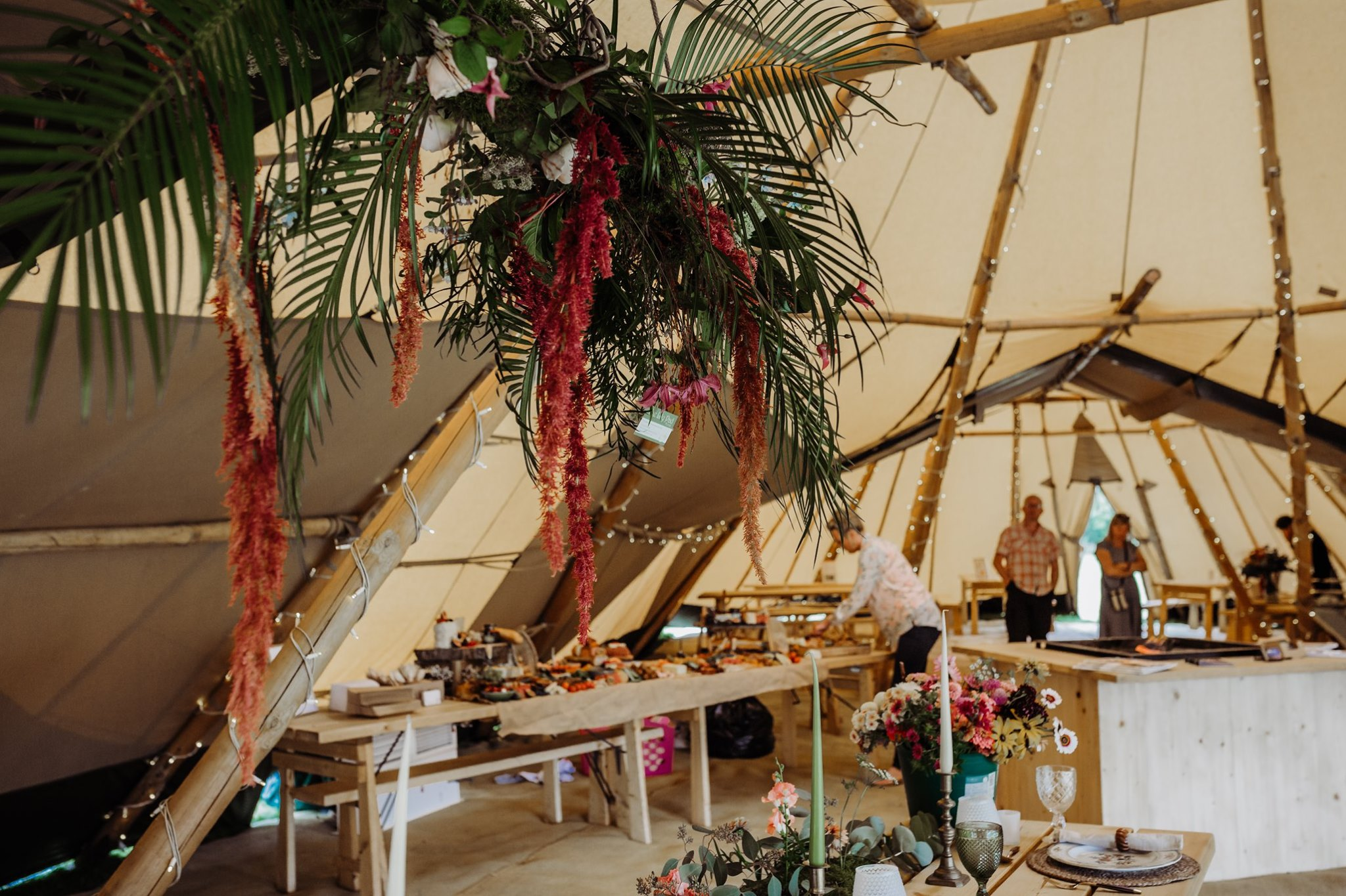 Interior image of Cotswold Tipis giant hat tipis with tropical hanging floral display by The Lily Pad Florist