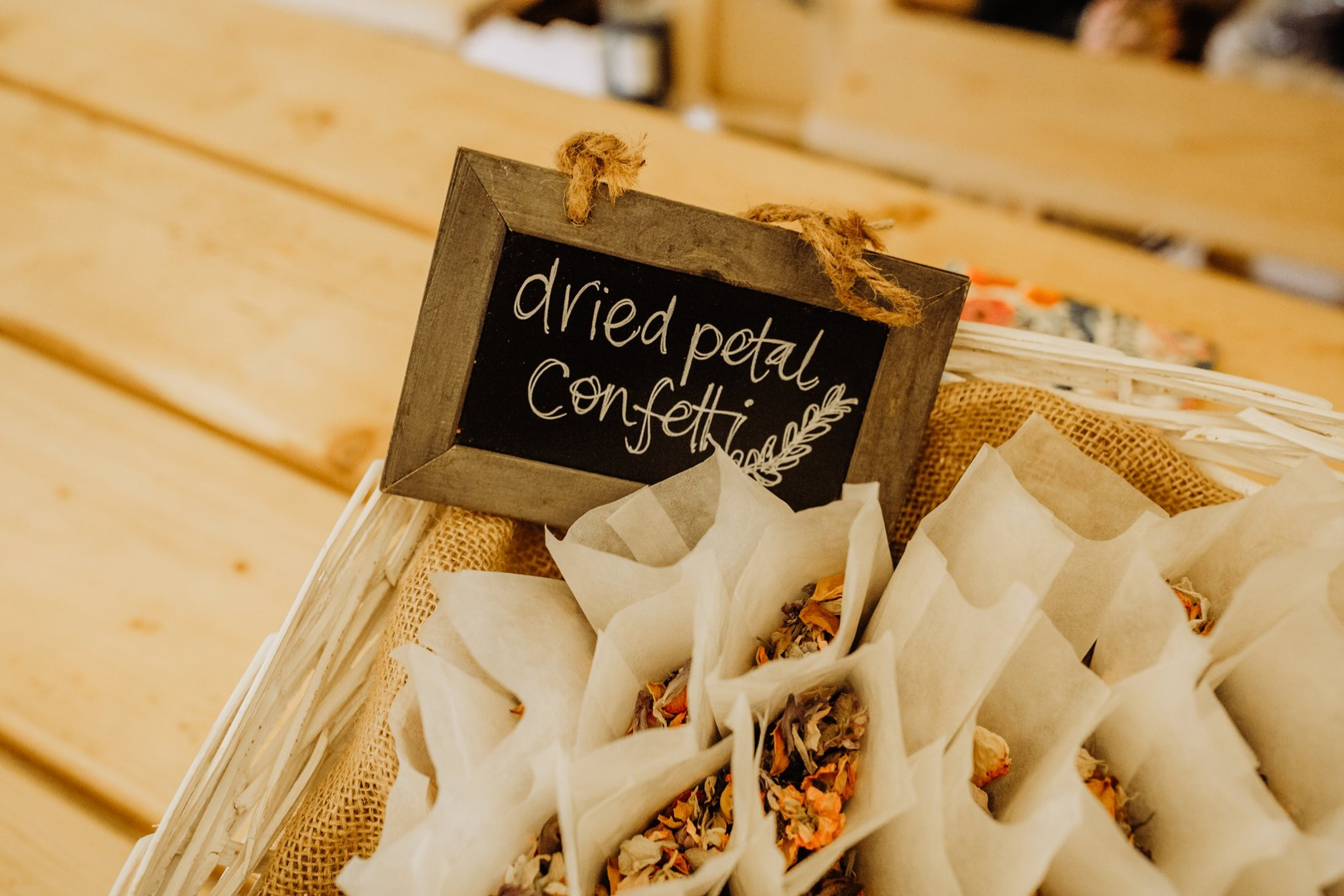 Eco-friendly dried petal confetti in paper bags by The Lily Pad Florist Stroud