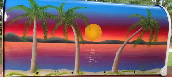 hand painted beach scene mailbox with setting sun