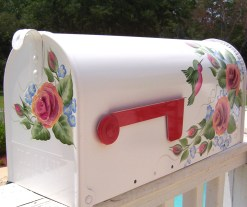 hand painted mailbox with roses and hummingbirds