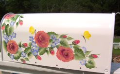 garland of roses and periwinkle flowers hand painted mailbox with yellow butterflies