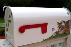hand painted mailbox with cat and a butterfly with paw prints going up the front