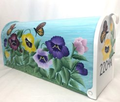 hand painted mailbox with a pansy garden