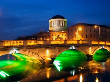With a wealth of history and heritage, great food, even better drink and a fascinating cultural quarter, Dublin is undoubtedly one of Ireland's 'must-sees'. This view is of night time at the city's Four Courts and bridge over the Liffey.