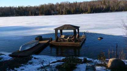 Deicer protecting floating dock