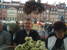 My dad caught me taking a picture in the main square in the Old Town of Warsaw featuring the statue of the symbol of the town- a mermaid.