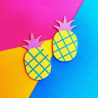 EDIT: sorry for the behind the scenes shot on the end there! 😂  🍍 Summer's almost here! 🍍  Is it just me, or are these funky pineapples giving off some major 80s/synthwave vibes?  I've been drowning in faux leather, glitter, and glue the past few weeks preparing for my upcoming markets, but I couldn't resist trying out a new colour version of these sparkly pineapples 🍍  These are up in the shop now, along with the regular gold versions (swipe to see), as earrings, necklaces, and more!  Do you prefer these fun neon ones or the more realistic gold ones?  . . . . . . . . #Handmade #handmadebusiness #handmadeisbetter #handmadelove #makersgonnamake #makersofinstagram #shopsmallbusiness #craftsposure #coloraddict #colorfullife #colormehappy #ihavethisthingwithcolor #crafttherainbow #ilovecolor #livecolorfully #handmadejewelry #shopsmall #shoplocal #smallbusiness #cuteearrings #earringswag #brightoncraft #veganjewelry #indieroller #btnetsy #synthwave #80saesthetic #summerjewellery #festivaljewellery #pineapples