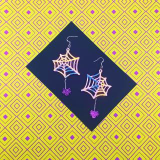 2.5 weeks to go til 🎃 Halloween 👻!   These spooky spider web earrings are holographic and have glittery purple spiders that hang off the web! How cute are these?! 🕷🕸   Like everything in my shop, they're made from vegan materials and delivered in eco-friendly packaging 💖  Are you doing anything fun for Halloween?! I looove haunted houses and scary movies. I just wish the UK did more trick or treating and decorating! I miss Halloween candy! 🍬  . . . . . . . .  #handmadebusiness #handmadeisbetter #handmadelove #makersgonnamake #makersofinstagram #shopsmallbusiness #craftsposure #colouraddict #colourfullife #colourmehappy #ihavethisthingwithcolour #crafttherainbow #ilovecolour #livecolourfully #handmadejewelry #shopsmall #smallbusiness #cuteearrings #earringswag #brightoncraft #veganjewellery #indieroller #btnetsy #statementearrings #statementjewellery #halloween #halloweenearrings #halloweenjewellery #spookyseason #spookyjewelry