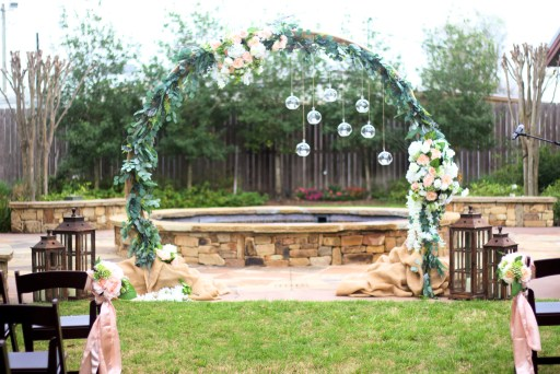 Outdoor wedding venue set up featuring a large ring alter.