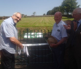 County Councillor Worthington cutting the ribbon