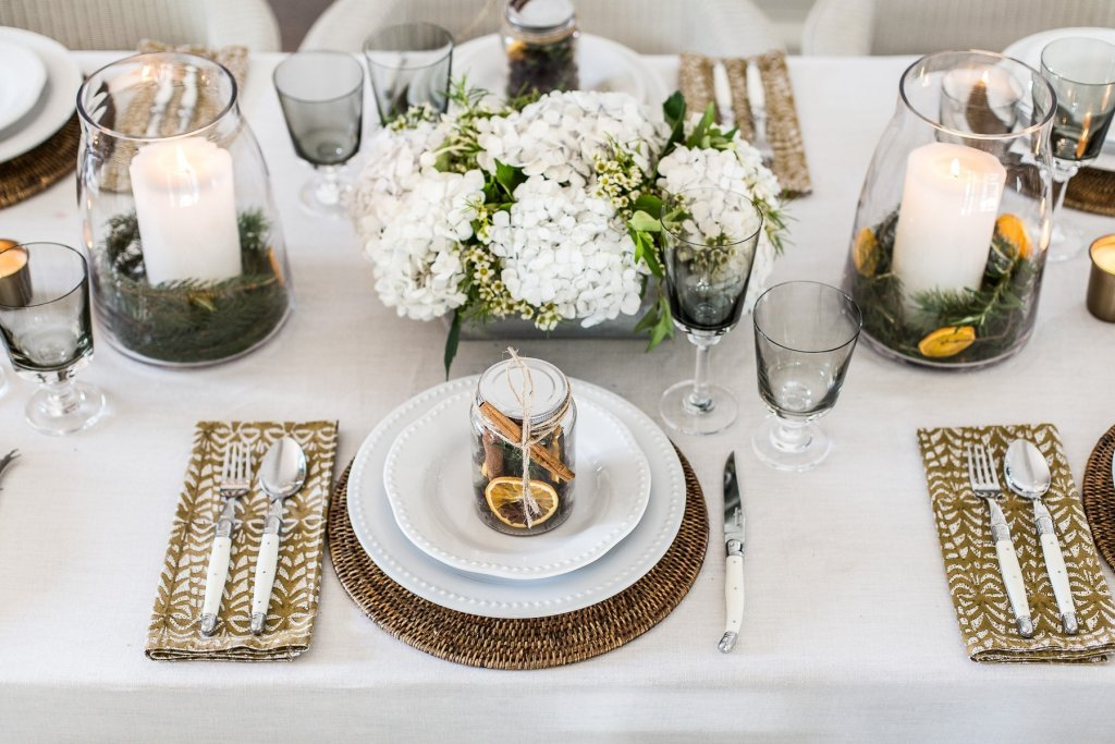 christmas table with napkins candles flower plates
