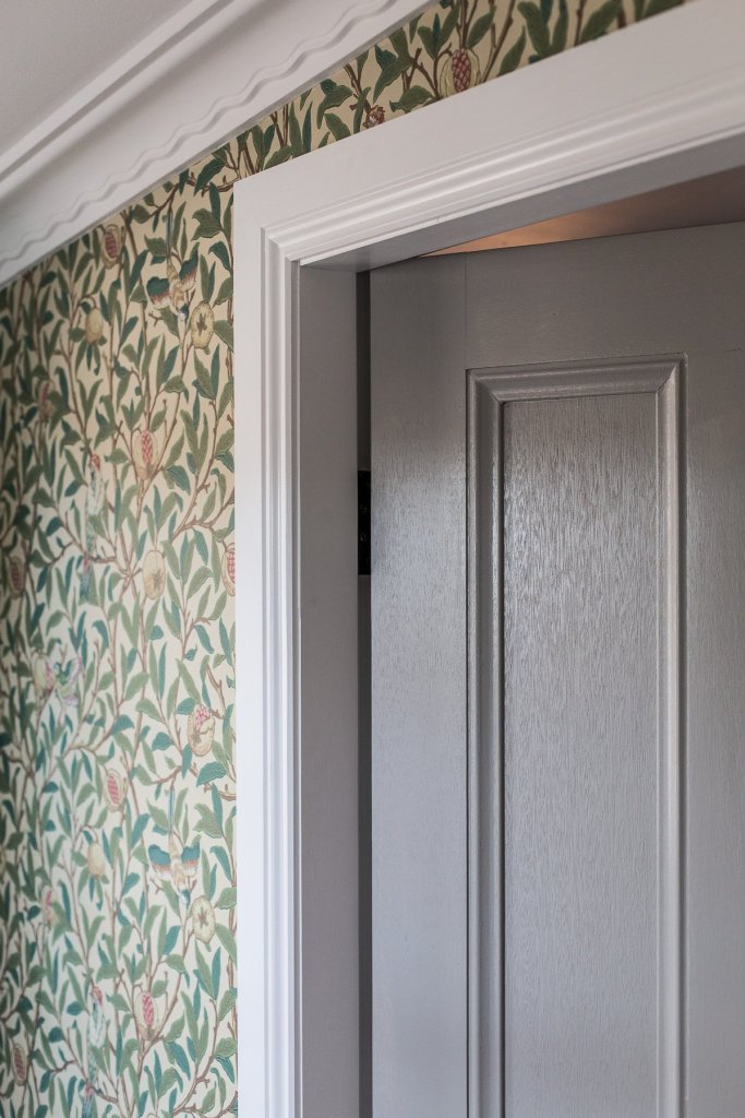 Cottage entry with William Morris wallpaper and architraves from Intrim Group