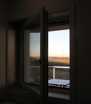 Tilt-n-turn window at dusk