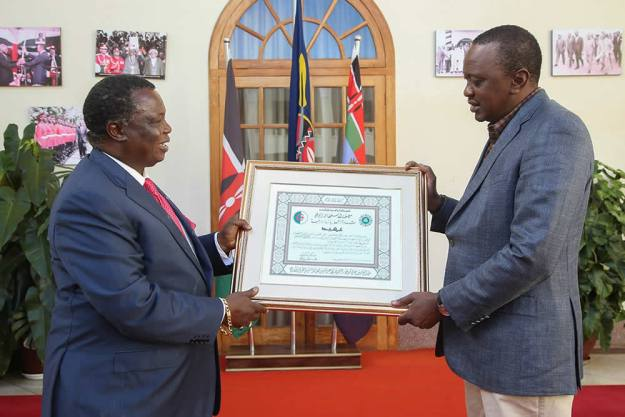President Uhuru congratulate COTU Secretary General Mr. Francis Atwoli for being awarded the National Order of Merit by Algeria President Abdelaziz Bouteflika
