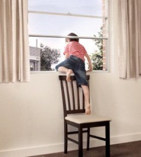 58_child_climbing_out_window